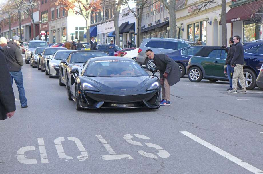A line including Mclaren 570s, Porsche Boxster Spyder, Mclaren 650s and Porsche GT4 at a Greenwich Cars & Coffee event held on Nov. 27, 2016, on Greenwich Avenue, in Greenwich, Conn. Photo: Contributed Photo / Robert Fong / Greenwich Time Contributed