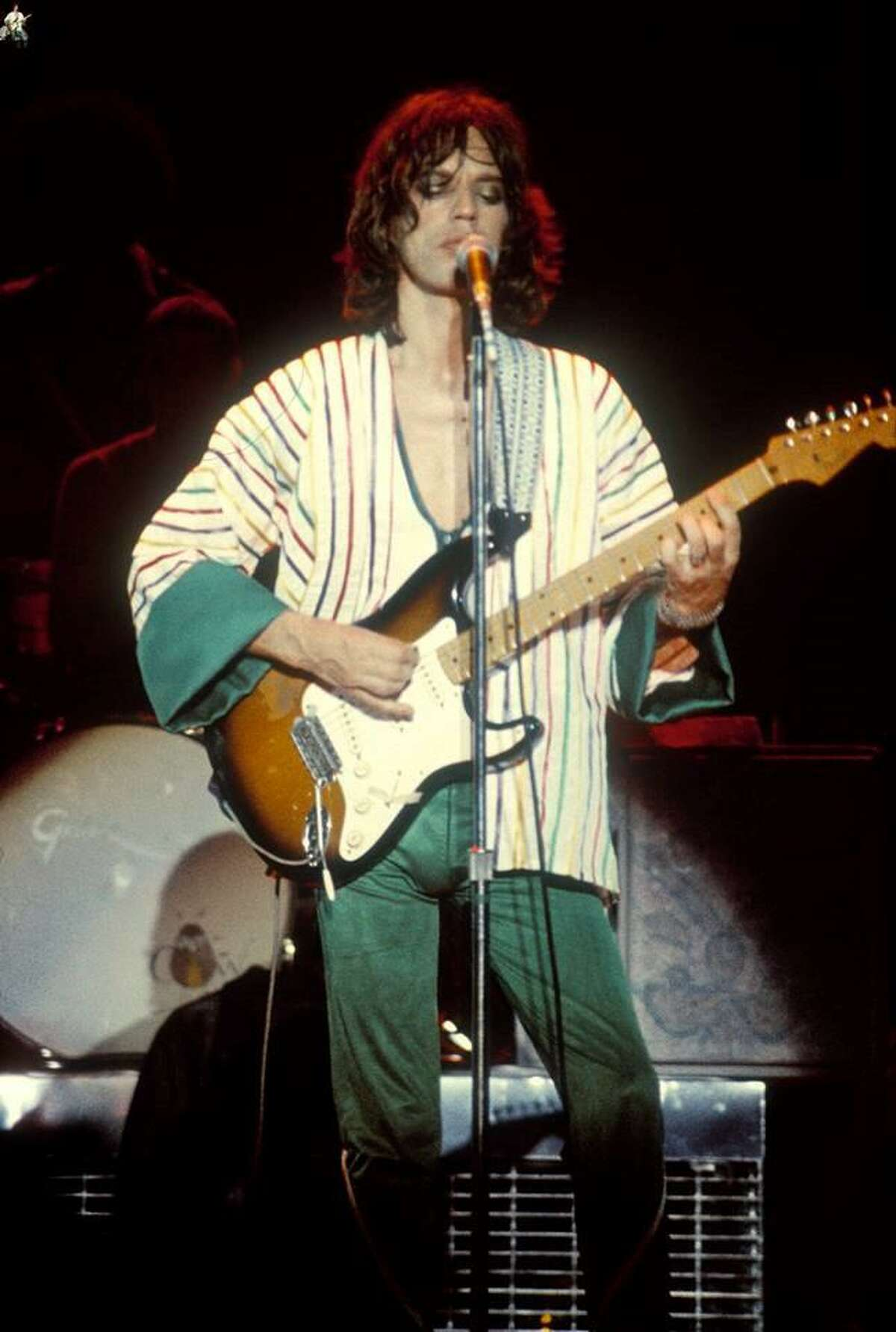 Mick Jagger plays electric guitar at a Rolling Stones concert on June 4, 1975, at the HemisFair Arena.