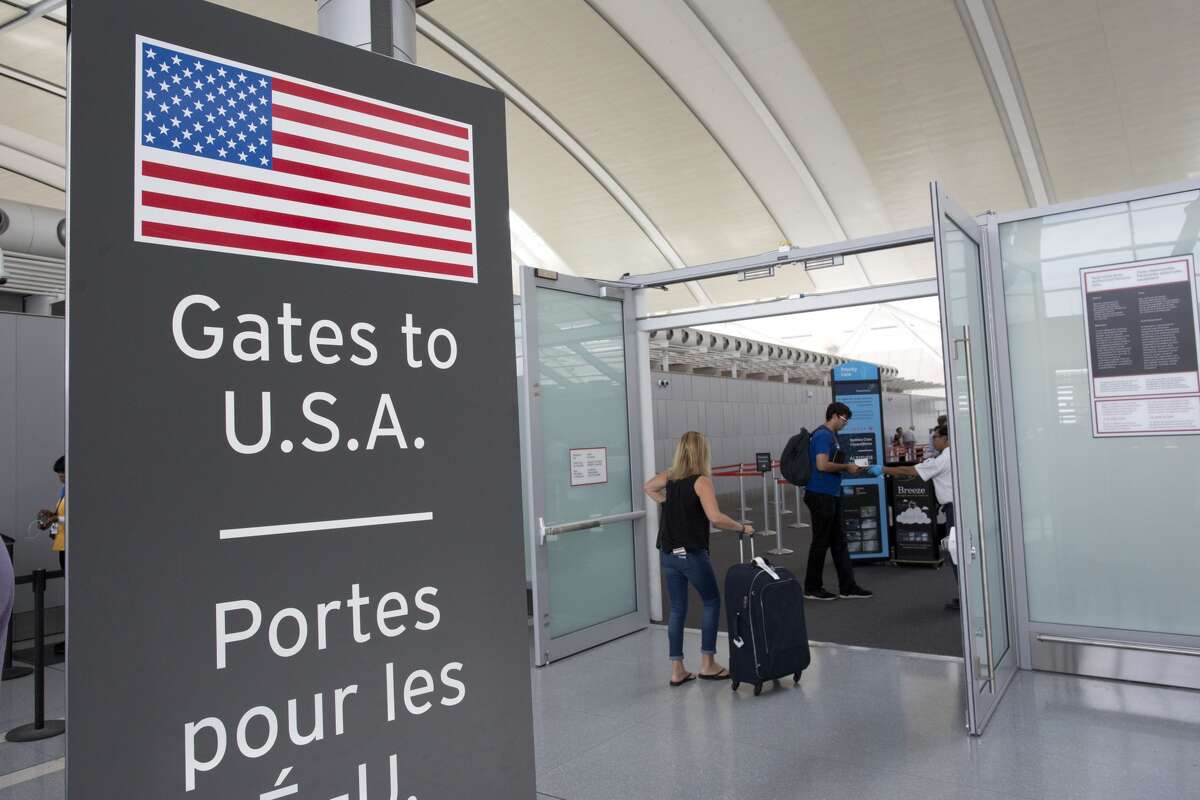 TORONTO, ON- JULY 19: Toronto's Pearson Airport unveiled a new pre-clearance security checkpoint Tuesday afternoon. Passengers travelling to the US will now pass security before clearing customs.