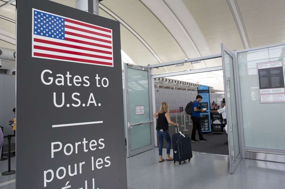 TORONTO, ON- JULY 19: Toronto's Pearson Airport unveiled a new pre-clearance security checkpoint Tuesday afternoon. Passengers travelling to the US will now pass security before clearing customs. (Lucas Oleniuk/Toronto Star via Getty Images)