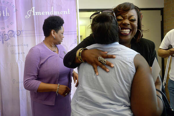 Honoree Camille Briggs gets a big hug of congratulations from Ashlee McGrew during the Pioneering Women 2017 Unveiling of Honorees ceremony Tuesday at City Hall. Seven area women who have exhibited strength and bravery in their work and community endeavors were highlighted at the free, public event. Photo taken Tuesday, March 21, 2017 Kim Brent/The Enterprise