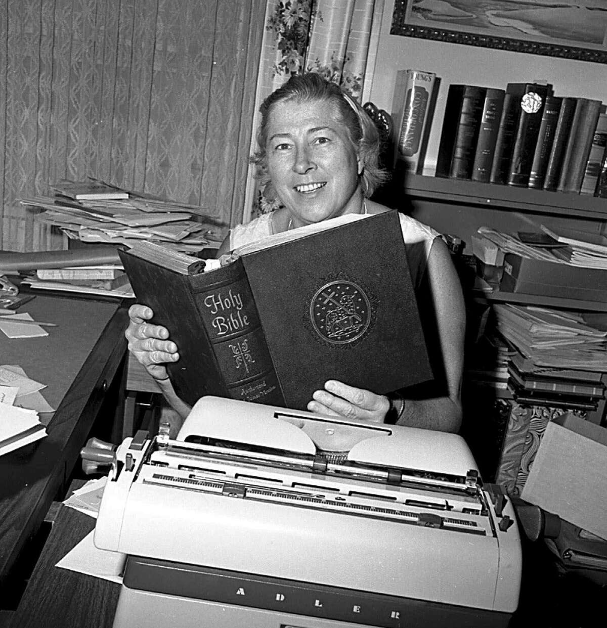 The real atheist leader Madalyn Murray O'Hair. She holds a copy of the Bible in her office in this Dec. 3, 1969 file photo.