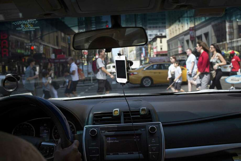 An Uber driver drives the streets of Manhattan. Uber, a worldwide ride-hailing gargantuan that once seemed unstoppable, has been rocked by tumult this year. The ugly split with its former president, Jeff Jones, further complicates attempts to navigate Uber's crises. Photo: Mark Kauzlarich /New York Times / NYTNS