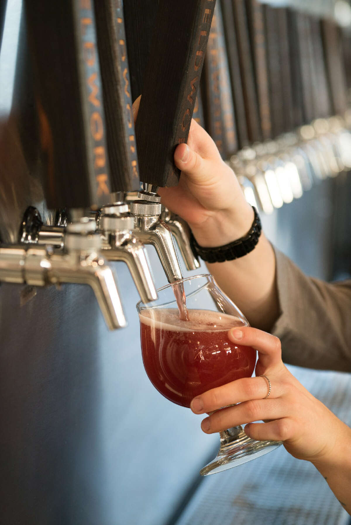 Curstin Perry pours a beer for a customer at the Fieldwork taproom in Napa.