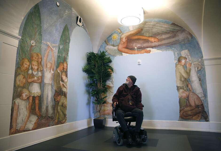 Richard Smallcomb views murals that were altered in previous developments inside the restored Richardson Hall on Laguna Street in San Francisco, Calif. on Tuesday, March 21, 2017. Smallcomb was among the first residents to move into Richardson in November, which at one time was part of the San Francisco State Teacher's College and was recently renovated as LGBT-friendly affordable housing for seniors.
