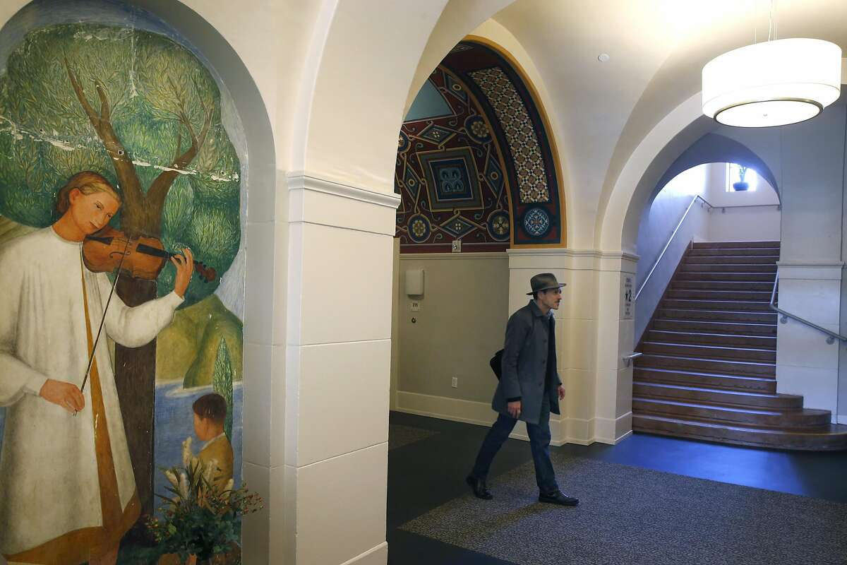 Architect Fred Pollack walks past preserved murals inside the restored Richardson Hall on Laguna Street in San Francisco, Calif. on Tuesday, March 21, 2017. At one time part of the San Francisco State Teacher's College, Richardson has been renovated as LGBT-friendly affordable housing for seniors.