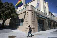 A rainbow flag flies from the corner of restored Richardson Hall where Laguna, Hermann and Market streets converge in San Francisco, Calif. on Tuesday, March 21, 2017. At one time part of the San Francisco State Teacher's College, Richardson has been renovated as LGBT-friendly affordable housing for seniors.