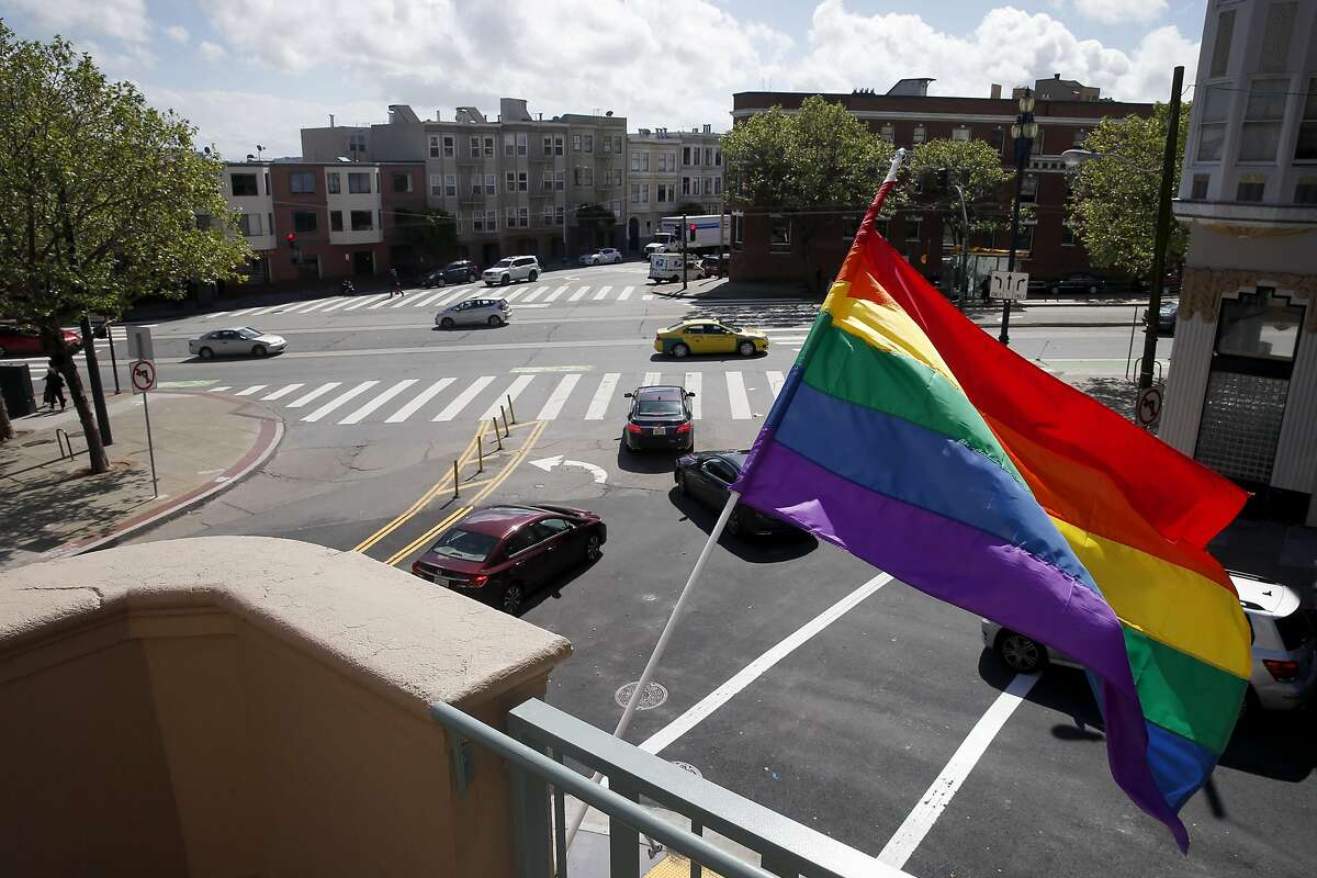 A rainbow flag flies from restored Richardson Hall where Laguna, Hermann and Market streets converge at new LGBT-friendly affordable senior housing in S.F.