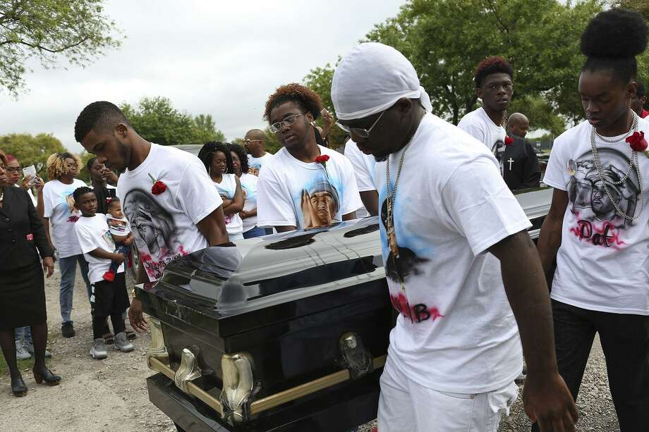 Pallbearers for Patrick Clark including cousin Jo Clark, from left, brother Devin Christian, brother Darrell King Jr., cousin Deontray King and cousin Cory Johnson carry Clark to the pavilion for his Celebration of Life at MeadowLawn Memorial Park on March 21, 2017. Photo: Lisa Krantz /San Antonio Express-News / © 2017 San Antonio Express-News