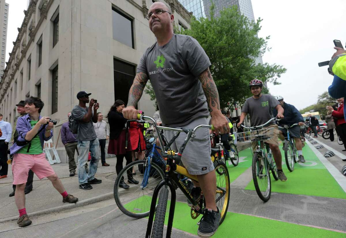 A pack of bicyclists try out the city's only dedicated bike lane, the 10-block-long Lamar cycle-track, in 2015.