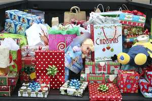 Donated Christmas presents are shown on the bed a of a truck outside Smoothie King, where Laredo RunStrong and Morning Crew running teams hosted their toy drive to benefit the Laredo Down Syndrome Associationon Saturday morning.