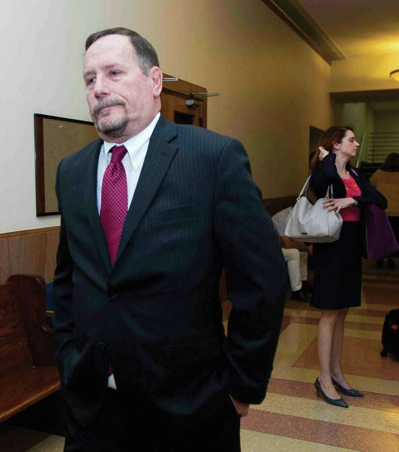 Political consultant Marc Davenport walks out of a courtroom at the Montgomery County Courthouse Monday, Oct. 3, 2016, in Conroe. Davenport along with Montgomery County Judge Craig Doyal and Precinct 2 Commissioner Charlie Riley are charged with violating the Texas Open Meetings Act for their alleged involvement in negotiating a $280 million road bond in November 2015. Photo: Jason Fochtman, Staff / Houston Chronicle