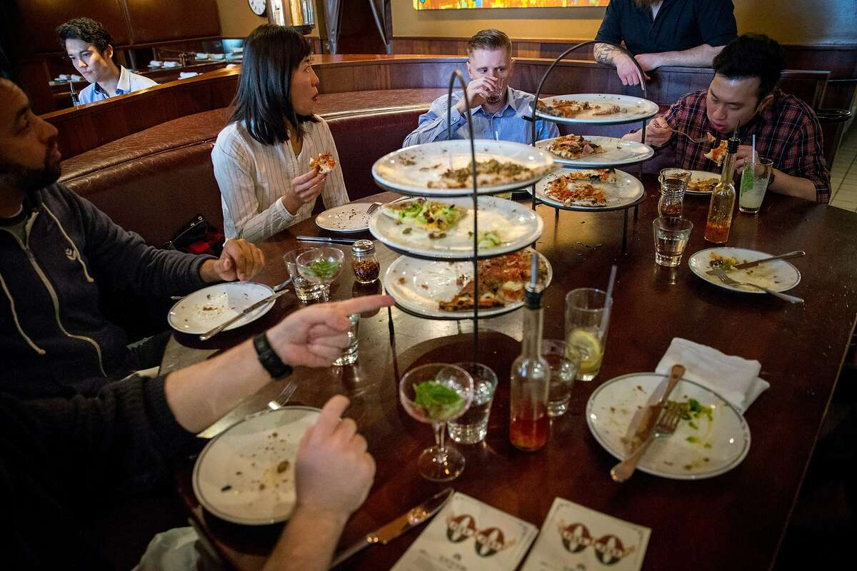 Top center: Henryk Sarat has lunch with friends and colleagues at Zero Zero, an Italian restaurant, on Tuesday, March 21, 2017, in San Francisco, Calif. The restaurant uses OpenTable to provide online reservations. OpenTable revealed a campaign today that spotlights the impact of reservation no-shows on the restaurant industry.