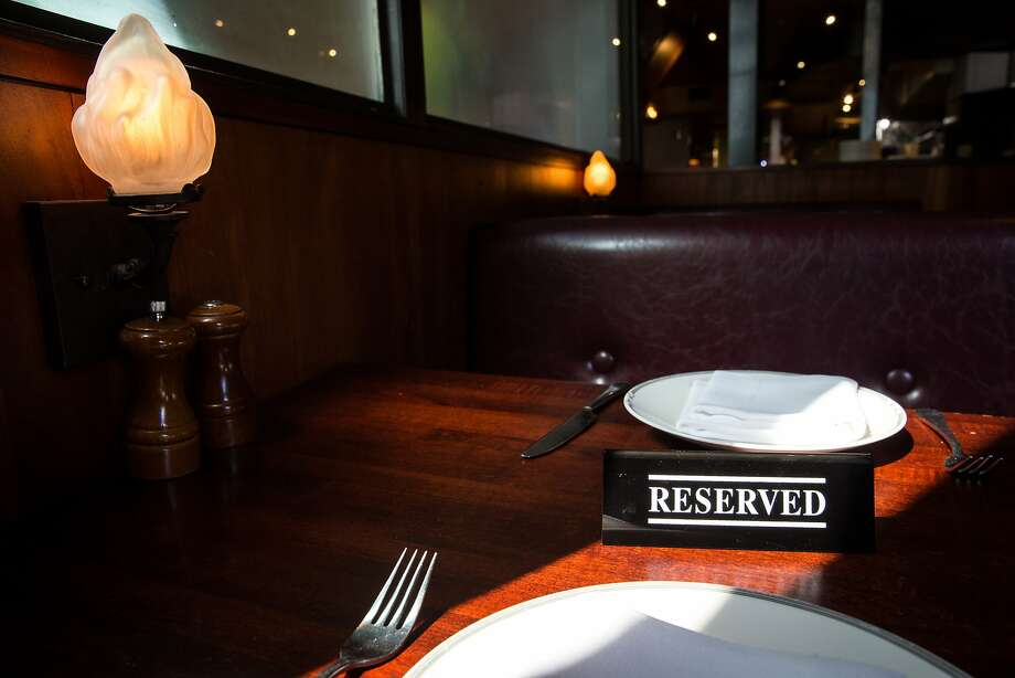 A reserved sign is set on a table at lunch at Zero Zero in San Francisco, which uses OpenTable to accept online reservations. Photo: Santiago Mejia, The Chronicle