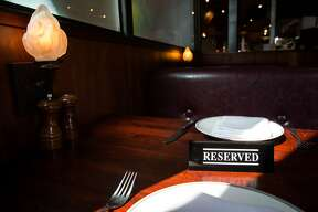A reserved sign is seen at Zero Zero, an Italian restaurant, on Tuesday, March 21, 2017, in San Francisco, Calif. The restaurant uses OpenTable to provide online reservations. OpenTable revealed a campaign today that spotlights the impact of reservation no-shows on the restaurant industry.