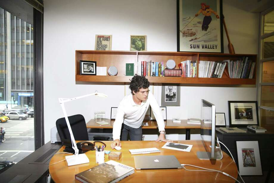 Gus Wenner, heir apparent to his father's media empire, including Rolling Stone, works at the offices of Rolling Stone in New York. After selling celebrity-focused Us Weekly magazine last week for $100 million, Rolling Stone owner Wenner Media will be debt-free for the first time in a decade, according to Wenner, who officially runs the company's online operation. And with the sale of a 49 percent stake in Rolling Stone last year, Wenner now has the funds to invest more in guiding the music and pop-culture icon into the digital age. Photo: New York Times /File Photo / NYTNS