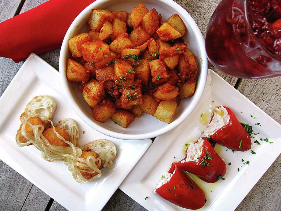 Toro Kitchen + Bar on specializes in Spanish tapas such as fried goat cheese with honey, patatas bravas and piquillos rellenos stuffed with cheese and serrano ham. Photo: Mike Sutter /San Antonio Express-News