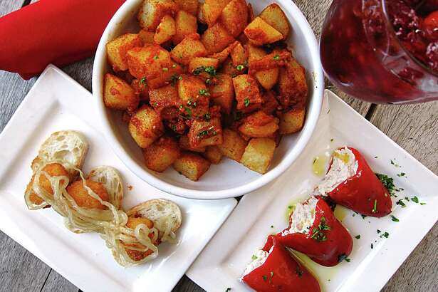 Toro Kitchen + Bar specializes in Spanish dishes like fried goat cheese with honey, patatas bravas and piquillos rellenos stuffed with cheese and serrano ham.
