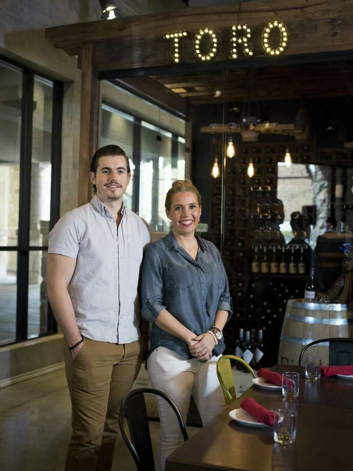 Co-owners and brother and sister Gerardo De Anda and Vanessa De Anda pose for a portrait at Toro Kitchen + Bar. Toro features straightforward Spanish food in a lively and casual atmosphere. Photo: Matthew Busch /For The Express-News / © Matthew Busch