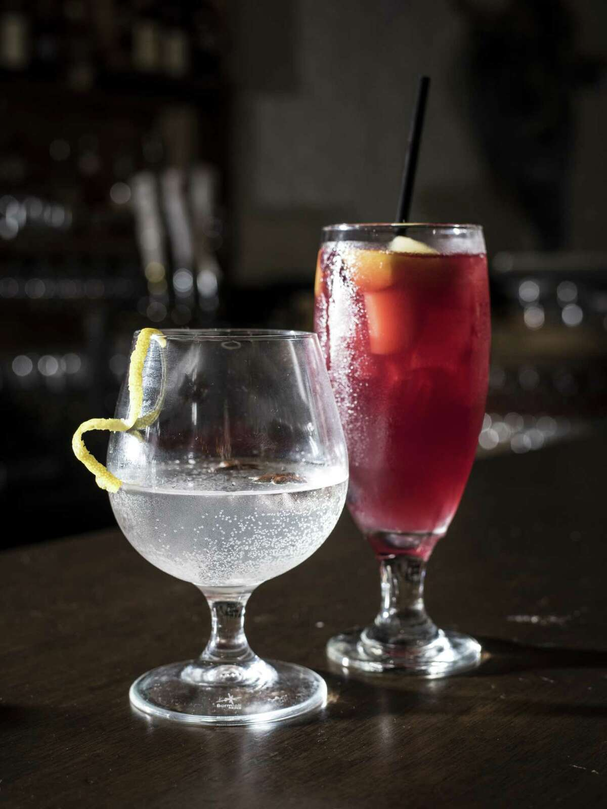 The gin-based Mallorca drink and Spanish sangria are featured at Toro Kitchen + Bar.