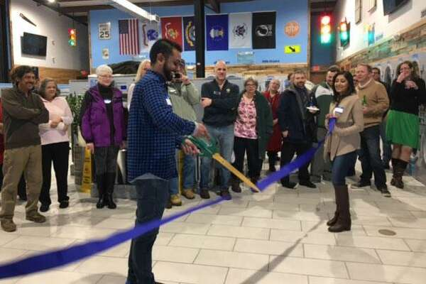 A crowd recently gathered for a ribbon-cutting ceremony, marking the opening of Stay Fresh Laundry in New Milford, owned by Neal Patel, shown cutting the ribbon.