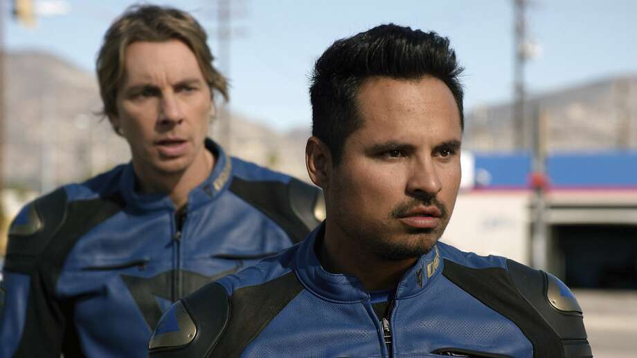 """This image released by Warner Bros. Pictures shows Michael Pena, foreground, and Dax Shepard in a scene from, """"CHiPS."""" (Warner Bros via AP) Photo: Associated Press"""