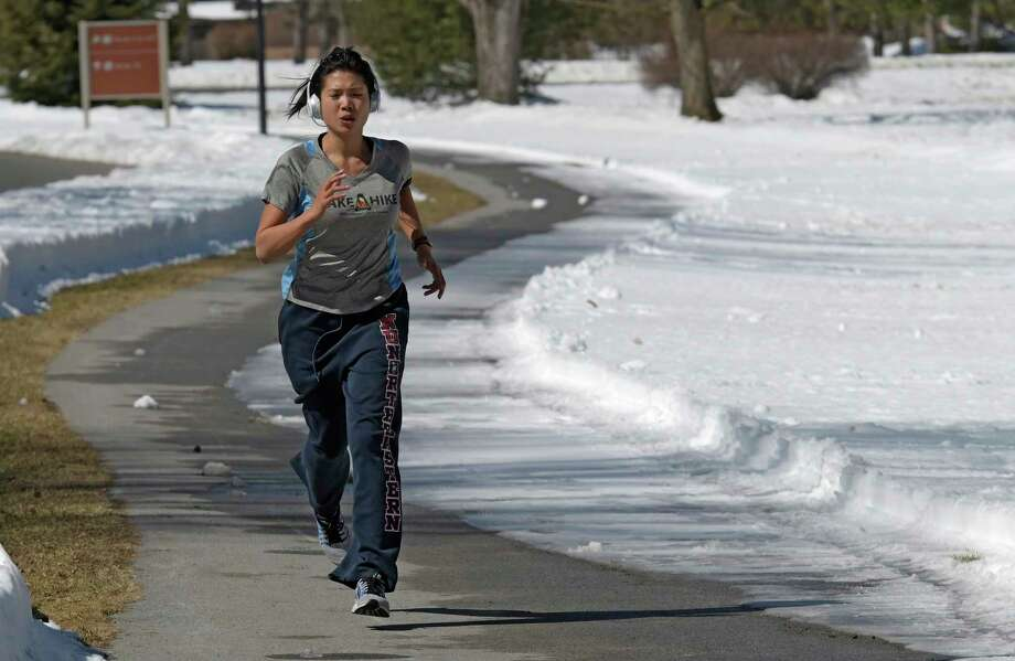 Enjoying the first day of spring is jogger and medical device representative Gwendolyn Ngai as she negotiates the running lanes at the Saratoga State Park Monday March 20, 2017 in Saratoga Springs, N.Y. (Skip Dickstein/Times Union) Photo: SKIP DICKSTEIN, Albany Times Union