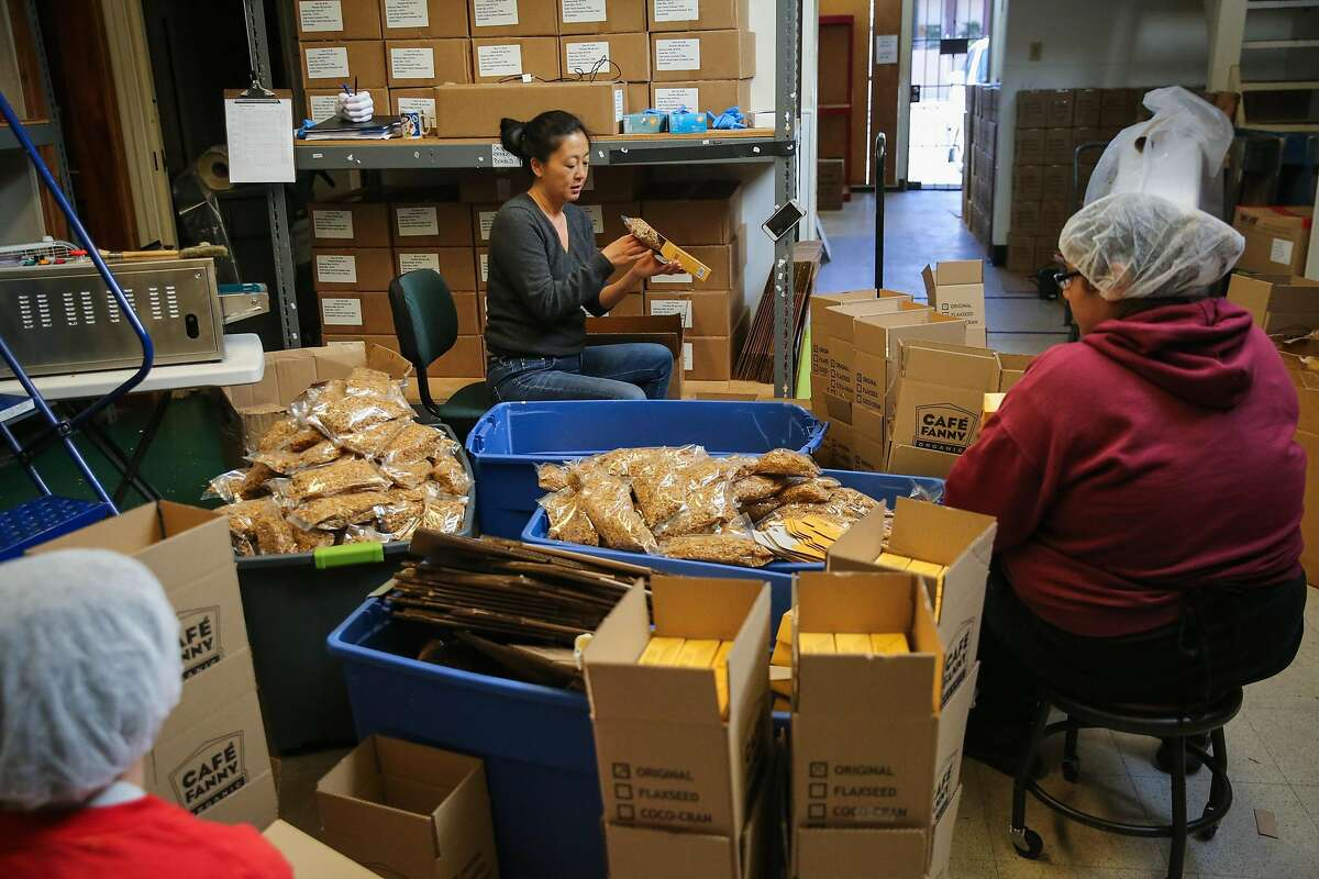 Cassandra Chen (center), owner of caramel company CC Made helps with packaging at their production facility Berkeley, California, on Tuesday, March 21, 2017.