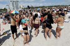 Spring breakers gather in South Beach, Monday, March 14, 2016, at Miami Beach, Fla. College students relax and have fun during their Spring Break.