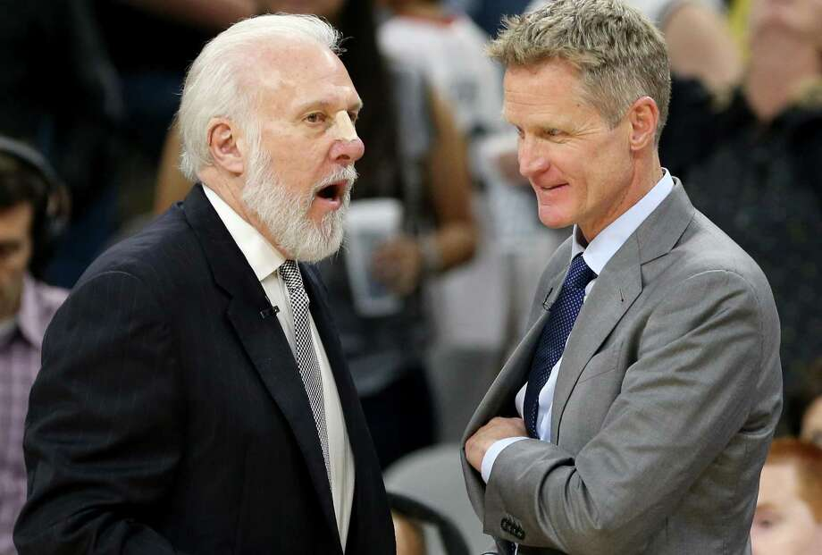 Spurs coach Gregg Popovich talks with Golden State Warriors coach Steve Kerr after the game on March 11, 2017 at the AT&T Center. Photo: Edward A. Ornelas /San Antonio Express-News / © 2017 San Antonio Express-News