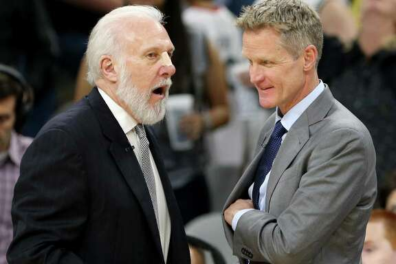 Spurs coach Gregg Popovich talks with Golden State Warriors coach Steve Kerr after the game on March 11, 2017 at the AT&T Center.