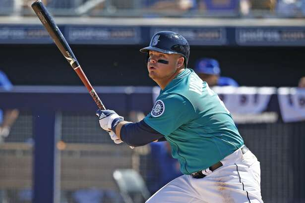 Seattle Mariners first baseman Dan Vogelbach watches the flight of his opposite field single against the Chicago Cubs during the fourth inning of a spring training baseball game Friday, March 10, 2017, in Peoria, Ariz. The Mariners defeated the Cubs 11-10. (AP Photo/Ross D. Franklin)