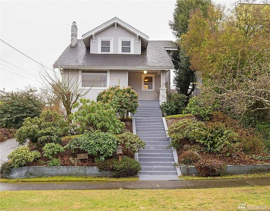 This classic (but updated) Craftsman has views of the city, sound, and Mount Rainier, in addition to a gas fireplace, hardwood floors and a roomy feel. The three-bedroom has a full bath with a large jetted tub and an air conditioner. The daylight lower unit has a second kitchen, rec room, laundry room and separate entrance, which makes for a good possible mother-in-law unit.The address is 2415 W. Boston St., listed at $1,000,000. See the full listing here. Photo: Listing Provided Courtesy Of Ginger Ard, Windermere R.E.