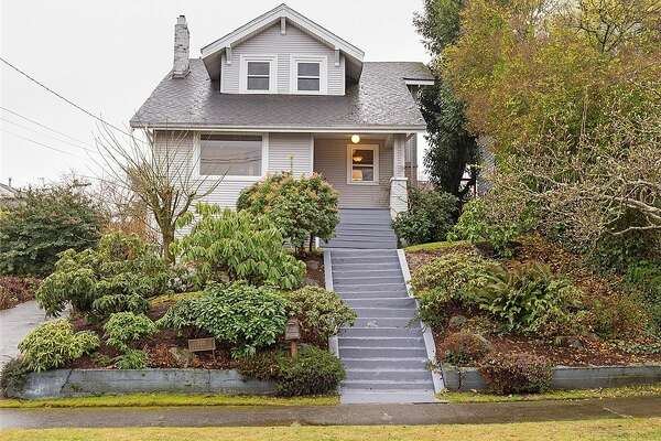 This classic (but updated) craftsman has views of the city, Sound, and Mt. Rainier, in addition to a gas fireplace, hardwood floors, and a roomy feel. The 3-bedroom has a full bath with a large jetted tub, and air conditioner. The daylight lower unit has a second kitchen, rec room, laundry room and separate entrance, which makes for a good possible mother-in-law unit.  