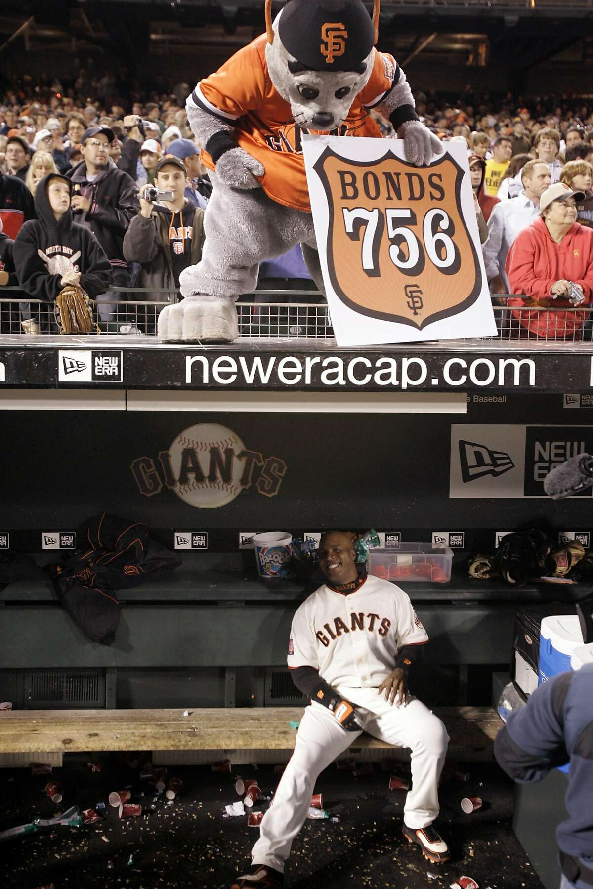 GIANTS07_df_008.JPG Lou Seal looks into the dugout after Barry Bonds hits home run number 756 in the bottom of the fifth inning. Washington Nationals play the San Francisco Giants at AT&T Park in San Francisco, CA, on Tuesday, August 07, 2007. Deanne Fitzmaurice / The Chronicle ** (cq) Ran on: 08-09-2007 Historic swing: Barry Bonds follows through on the swing that sent his 756th home run soaring 435 feet into the center-field bleachers. On contact, there was no question the ball would reach the stands. Bonds knew it and stayed in the batters box, raising both arms as he took his place atop the all-time home run list.