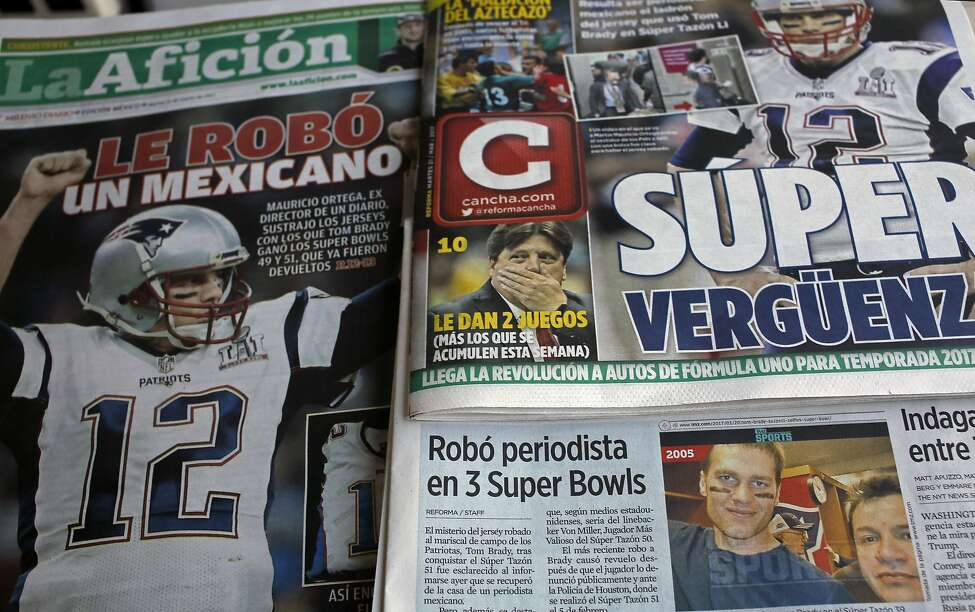 Front pages of Mexican newspapers show headlines and photos about the Tom Brady Superbowl jersey that was allegedly stolen by a Mexican journalist, bottom left on a selfie with Brady, in Mexico City, Mexico March 21, 2017. The headlines read in Spanish