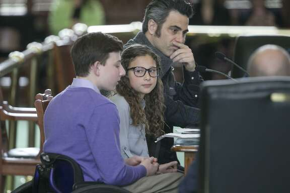 Aaron Berry, left, and his sister Willa Berry, center, joined their uncle, Adam Berry, right, in testifying before the Texas Senate State Affairs Committee hearing on Senate Bill 31, a statewide ban on texting while driving. The children lost their parents, who both died in an accident in which the driver of the other vehicle was distracted by texting. A reader says he does not understand how anyone could oppose a ban on texting while driving.