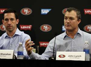 San Francisco 49ers general manager John Lynch, right, gestures beside head coach Kyle Shanahan during an NFL football news conference Friday, March 10, 2017, in Santa Clara, Calif. (AP Photo/Ben Margot)
