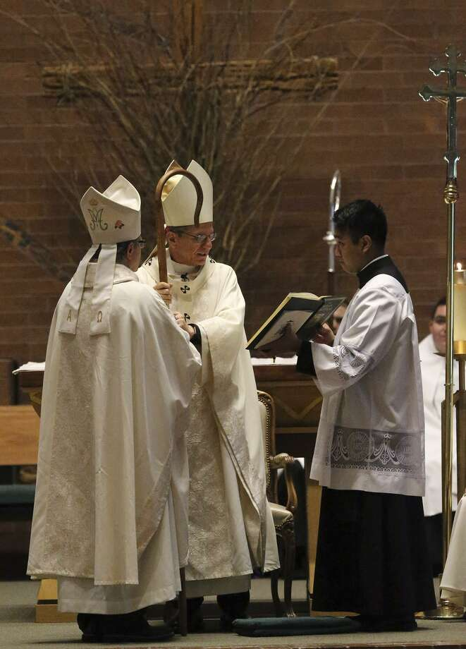 Archbishop Gustavo Garcia-Siller (center) hands Michael Boulette a crosier Monday March 20, 2017 during Boulette's ordination at St. Mark the Evangelist Catholic Parish. Boulette is now Auxiliary Bishop of the Archdiocese of San Antonio. Photo: John Davenport, STAFF / San Antonio Express-News / ©San Antonio Express-News/John Davenport