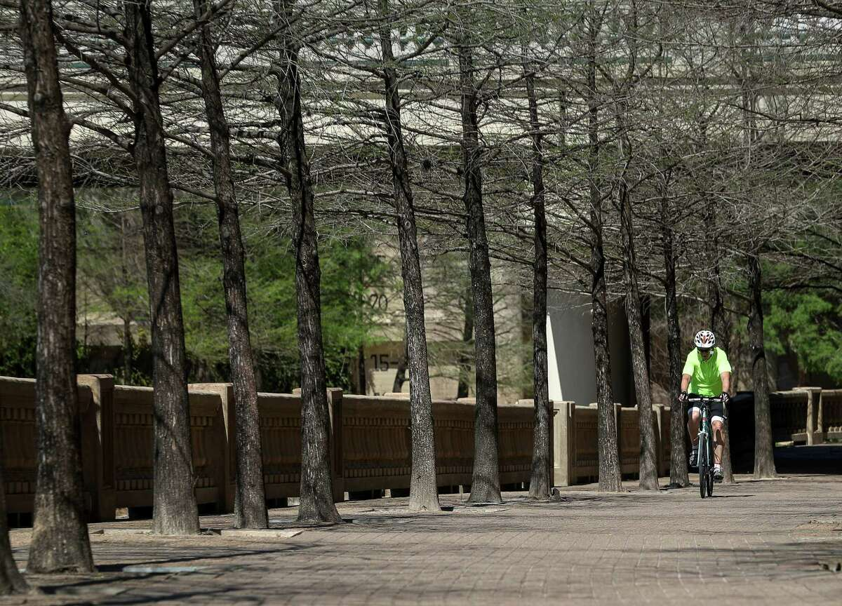 A cyclist rides on a trail along Buffalo Bayou near downtown Houston on March 21. Officials would like to connect the bayou trails via north-south connections along utility corridors.