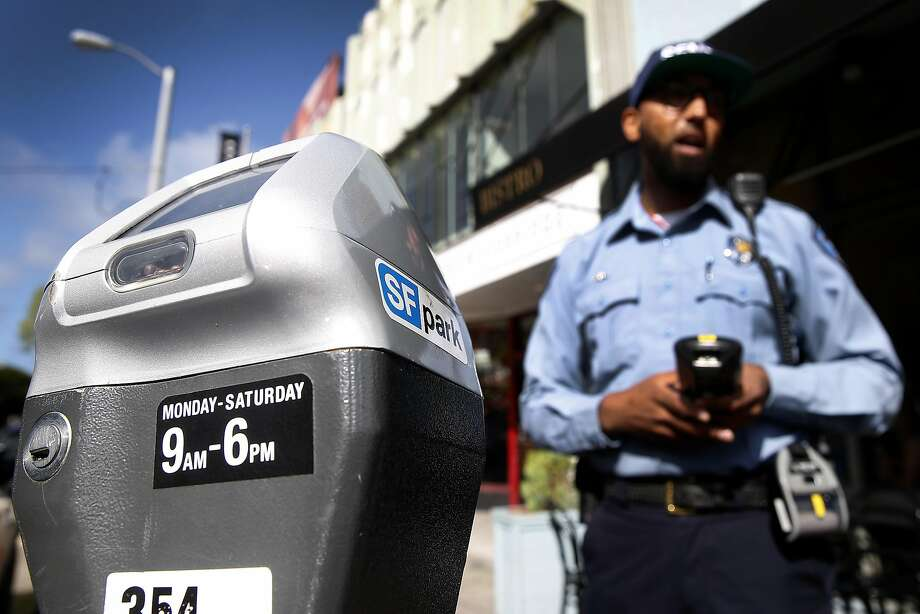 If your car is parked in San Francisco, the last thing you want to see next to it is an SFMTA parking enforcement officer making out a citation. Here are some more one-star reviews of SFMTA on Yelp. Photo: Paul Chinn, The Chronicle