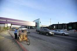 The Cross Border XPress pedestrian bridge between San Diego and the Tijuana Airport on December 8, 2015, with a street vendor outside the Tijuana, Mexico, airport. (Alejandro Tamayo/San Diego Union-Tribune/TNS)
