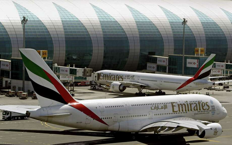 FILE - This May 8, 2014 file photo shows Emirates passenger planes at Dubai airport in United Arab Emirates. The U.S. government is temporarily barring passengers on certain flights originating in eight other countries from bringing most types of electronics in their carry-on luggage. A U.S. official tells The Associated Press that the ban beginning Tuesday, March 21, 2017, affects airports in 10 cities of Cairo in Egypt; Amman in Jordan; Kuwait City in Kuwait; Casablanca in Morocco; Doha in Qatar; Riyadh and Jeddah in Saudi Arabia; Istanbul in Turkey; and Abu Dhabi and Dubai in the United Arab Emirates. in the Middle East, North Africa and Turkey. (AP Photo/Kamran Jebreili, File) Photo: Kamran Jebreili / Associated Press / Copyright 2016 The Associated Press. All rights reserved.