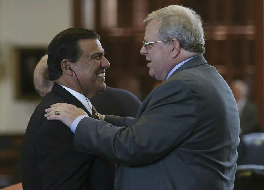 Texas Senator Paul Bettencourt, R-Houston, right, is congratulated by Sen. Eddie Lucio Lucio, Jr., D-Brownsville, after his property tax bill passes the senate, Tuesday, March 21, 2017. The bill, SB2, puts further restrictions on city and county property tax revenues and was approved by the senate. The bill will move on to the House of Representatives. Photo: JERRY LARA / San Antonio Express-News / © 2017 San Antonio Express-News