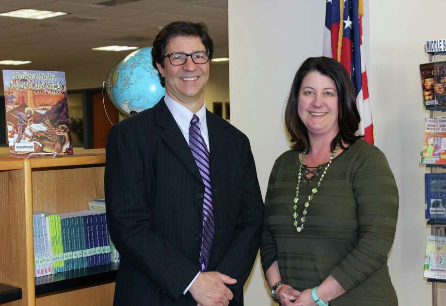 Tamarac Secondary Principal Richard Pogue was honored with the New York Library Association – Section of School Librarians Secondary Administrator Award for his support, advocacy, and funding of the school's library program. Librarian Michelle Furlong, right, nominated Pogue for the award. She credits him with spearheading the creation of an entirely new curriculum, Honors Seminar classes for ninth and tenth grade students in need of extra enrichment. (Brunswick Cenral School Dsitrict photo)