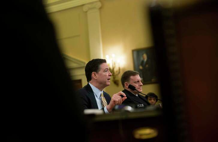 FBI Director James Comey and Adm. Michael Rogers, director of the National Security Agency, testify before the House Permanent Select Committee on Intelligence on Capitol Hill in Washington Monday.  (Eric Thayer/The New York Times)
