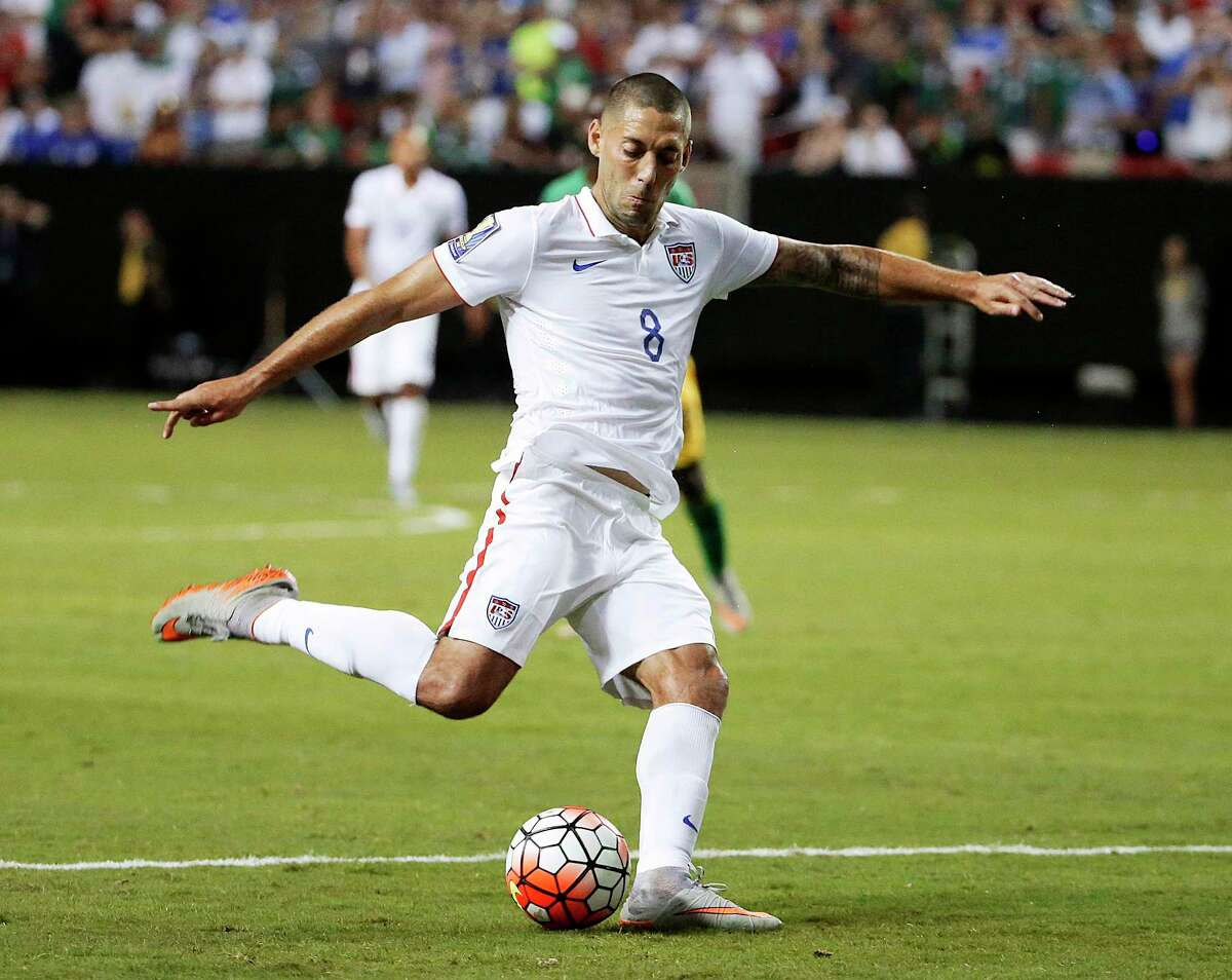 FILE - In this July 22, 2015, file photo, United States' Clint Dempsey shoots at goal during the second half of a CONCACAF Gold Cup semifinal soccer game against Jamaica in Atlanta. Dempsey, DaMarcus Beasley and Tim Howard have been around with Bruce Arena since the last time the U.S. coach guided the Americans into World Cup qualifying, way back 12 years ago. Now, these three will be counted upon to help lead the Americans in their World Cup qualifier Friday against Honduras in San Jose, California. (AP Photo/David Goldman, File) ORG XMIT: NY171