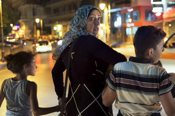 Sham, Yaman and Lulu in Lesbos, Greece, September 2015 (Amanda Bailly)