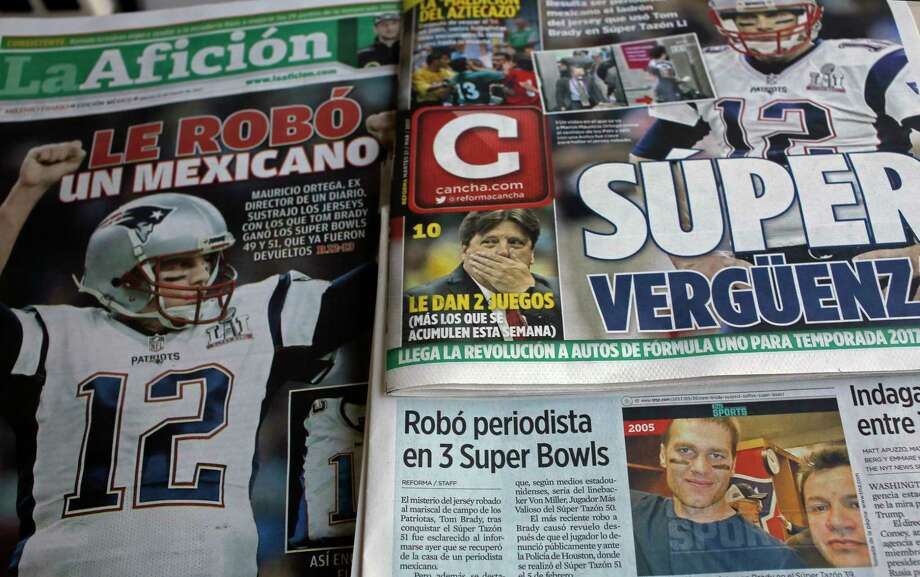 "Front pages of Mexican newspapers show headlines and photos about the Tom Brady Superbowl jersey that was allegedly stolen by a Mexican journalist, bottom left on a selfie with Brady, in Mexico City, Mexico March 21, 2017. The headlines read in Spanish ""Super embarrassment"" top right and ""Was stolen by a Mexican,"" left. (AP Photo/Enric Marti) ORG XMIT: MXEM101 Photo: Enric Marti / Copyright 2017 The Associated Press. All rights reserved."