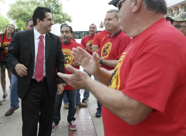 San Antonio mayoral candidate Manuel Medina greets people Tuesday, March 21, 2017 at City Hall before receiving the endorsement of the San Antonio Professional Firefighters Association in a news conference on the city hall steps.